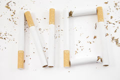No smoking. No cigarette inscription on the white background Stock Photos