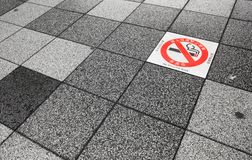 No smoking area warning on pavement. Royalty Free Stock Images