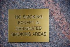 No smoking. Brass plate engraved with a no smoking warning stock photo