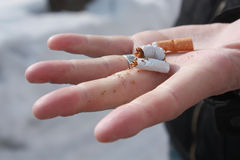 No smoking. Broken cigarette in the hand of a man who gave up smoking Stock Images