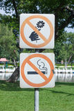 No smoking and do not pick flower, metal sign in the park Royalty Free Stock Photo
