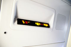 No Smoking and Fasten Seat belt Sign Inside an Airplane Stock Photos