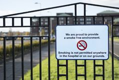 No smoking On Hospital Property Grounds Sign. No smoking sign on hospital grounds or property, smoke free environment Stock Photography