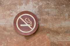 No smoking label put on old cement wall background. No smoking wood label put on old cement wall background Stock Photography