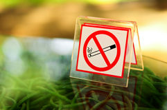 No smoking metal sign on the table Stock Photo