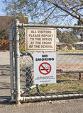 No smoking and other signage at the entrance of a school Royalty Free Stock Image