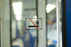 No smoking, please. No smoking sign in a train Stock Photography