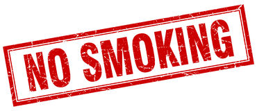 No smoking red square grunge stamp. On white Stock Photo