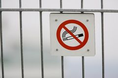 No smoking sign. A no smoking sign posted on a fence Stock Photography