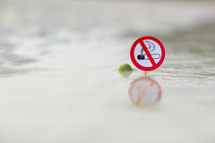 No smoking sign on the beach. On sea background stock photography