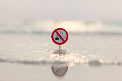 No smoking sign on the beach. On sea background Royalty Free Stock Image