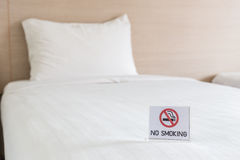 NO SMOKING Sign on the bed in hotel room Royalty Free Stock Photos