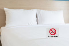 NO SMOKING Sign on the bed in hotel room Stock Photography