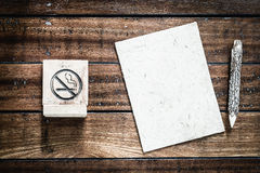 No Smoking sign and blank mulberry paper and wooden pencils wit Royalty Free Stock Photography