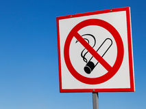 No smoking sign on blue sky Royalty Free Stock Photos