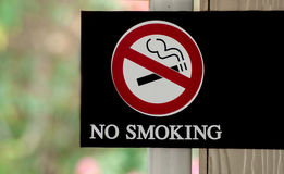 No smoking sign and blur background Stock Images