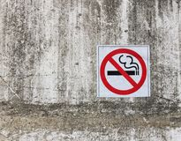No smoking sign on concrete wall Stock Photos