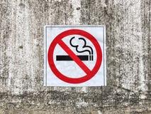 No smoking sign on concrete wall Royalty Free Stock Photo
