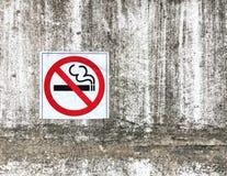 No smoking sign on concrete wall Stock Photo