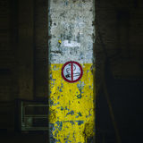 No Smoking sign on damaged wall Stock Images