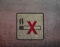 No smoking sign on the dirty metal wall Stock Image