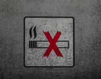 No smoking sign on the dirty metal wall Royalty Free Stock Photo