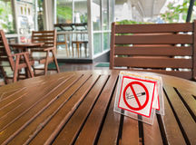 No smoking sign displayed on a table Stock Photography