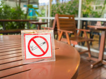 No smoking sign displayed on the wooden table Stock Photography
