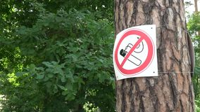 No Smoking sign in green area stock video footage