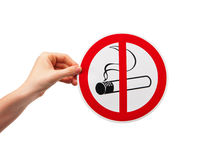 No Smoking Sign in the hand on white background Royalty Free Stock Images