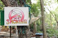 No smoking sign hang on tree Royalty Free Stock Photos
