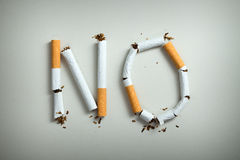 No smoking. Sign made with broken cigarettes Royalty Free Stock Images
