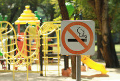 No smoking sign near children`s playground Stock Photos