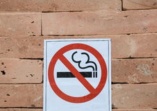 No smoking sign on orange brick wall Stock Images