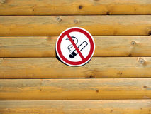 No smoking sign on painted wooden wall of horizontal planks Stock Image