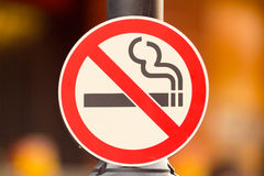 No smoking Sign. On Pole in Public Place royalty free stock images