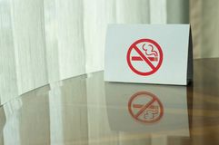 No smoking sign on the table. royalty free stock photography