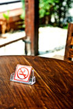 No smoking sign on wood table Stock Photo