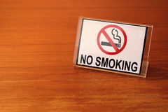 No smoking sign on wooden table Stock Image