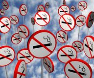 No Smoking Signs. Illustrated no smoking signs over a cloudy photo royalty free illustration