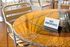 No smoking table in outdoor cafe Stock Images