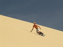 No snowboard, it's a sandboard Stock Images