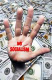 No Socialism hand. Coming out of pile of hundred dollar bills royalty free stock photo