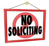 No Soliciting Sign Prohibit Unwanted Uninvited Salespeople Selli. No Soliciting sign in a home or business window to prevent unwanted and uninvited salespeople Stock Images