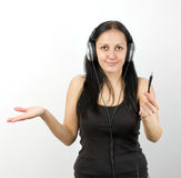 No sound. Young beautiful happy woman listening music in headphones stock photo