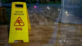 No sound footage, standing yellow caution wet sign, while rainy day stock footage