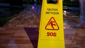 No sound footage, standing yellow caution wet sign, while rainy day stock video footage