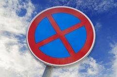 No Stopping and No parking sign isolated on blue cloudy sky. Background stock photos