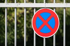 No Stopping Road sign on a fence royalty free stock image