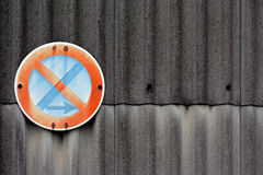 No stopping sign on a asbestos wall Stock Image